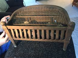 an antique cast iron fireplace insert it is a type of