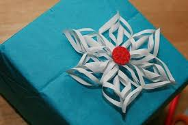 paper gift bows make christmas presents look better with these cheap easy gift