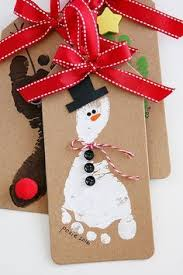handprint snowman ornament paint markers paint and clear