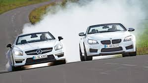 bmw vs mercedes bmw m6 convertible vs mercedes sl 63 amg open air turbos with