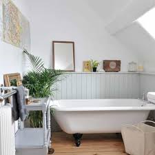 clawfoot tub bathroom design country small space bathroom design with mirror and houseplant and
