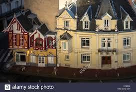 tiny vintage chalet built onto big residential blocks vichy stock