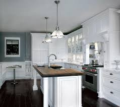 kitchen white cabinet beside hoods above stove and oven closed