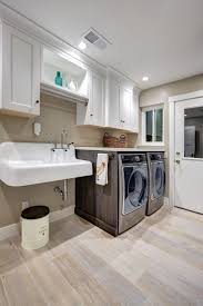 best 25 laundry room sink ideas on pinterest laundry room the white cabinets and sink in this laundry room give the space a clean look