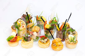 mini canape mini canape with and vegetables in plastic cups stock photo