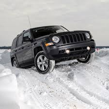 jeep patriot 2016 black off road in the snow with jeep
