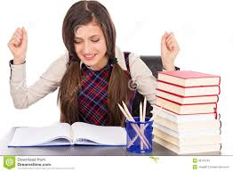 Student At Desk by Happy Student Sitting At Desk Hands In The Air Stock Photo