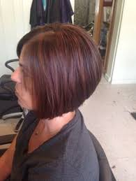red brown long angled bobs victoria beckham with angled bob haircut in brown with caramel