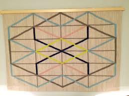 Ikea Rug by Creating A Wood Quilt Hanger Turns An Ikea Rug Into A Wall