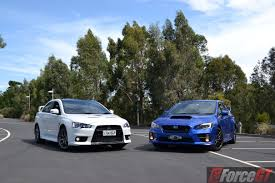 subaru wrx slammed head to head subaru wrx sti vs mitsubishi lancer evo x final edition