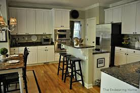Kitchen With White Appliances by Brown Granite White Cabinets Backsplash Ideas
