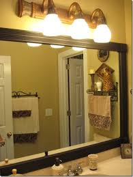 peahen pad framing an existing bathroom mirror framing those boring mirrors southern hospitality an old bathroom