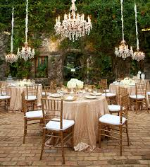 rental tablecloths for weddings these blush sequin tableclothes and low hanging chandeliers are