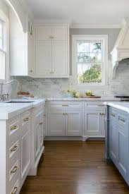white kitchen with stacked cabinets and grey island home bunch