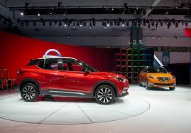 nissan kicks red la auto show tesla model 3 range porsche plug ins what u0027s new