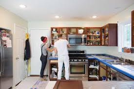 painting kitchen cabinet doors different color than frame how to paint wood kitchen cabinets with white paint kitchn