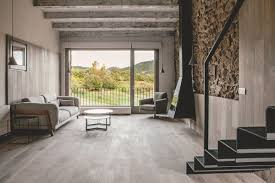 rustic home rehabilitated with a modern twist rustic house gets rehabilitated in spain living room stone wall