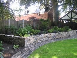 raised planting border build in dressed dry stone walling with