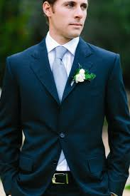 groom navy blue suit rose and fern boutonniere rustic luxe
