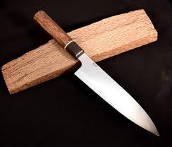 laser kitchen knives sold 52100 carbon steel 200 mm gyuto red oak ebony