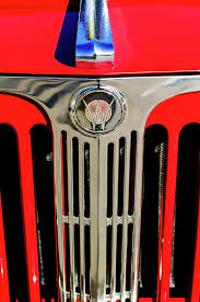 1949 willys jeepster ornament and grille photograph by reger