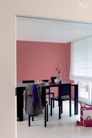 a strong pink can be grounded and mellowed by a warm neutral