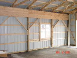 Setting Pole Barn Posts Pole Barn Buildings Steel Buildings For Sale Metal Building Kits