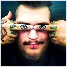 35 not so common eye tattoo designs