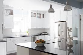 white kitchen cabinets with black quartz black quartz countertops cottage kitchen beth design