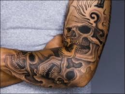 grey skull tattoos on left sleeve