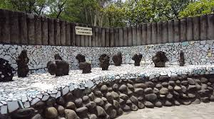 colorful statues made of recycled bangles rock garden of