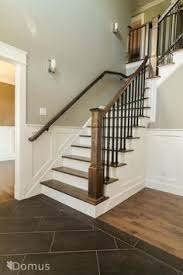 staircase with white accents and black metal spindles and shoes