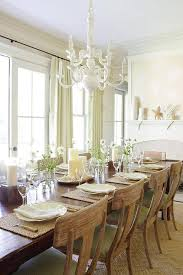 dining table in front of fireplace beige and green dining room with fireplace cottage dining room