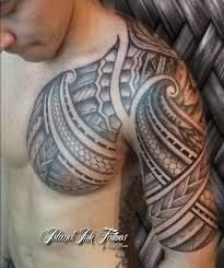 impressive polynesian tattoos on chest and half sleeve photos