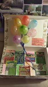 a box filled with lottery tickets and pop up balloons is a lucky
