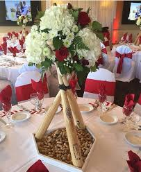 baseball wedding table decorations looking for a fun idea to incorporate baseball bats and florals at