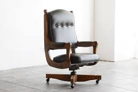 swivel captains chair sold antique chesterfield captains chair in oak and leather
