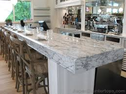 carrera marble countertops classic kitchen design with white