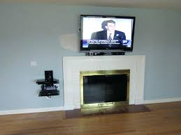 Mounting Tv Over Brick Fireplace by Mounting Tv Above Fireplace Hiding Wires Download Wall Mount Over