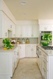 white kitchen cabinets with tile floor paint everything white and that will instantly update your