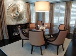 bedroom glamour dining room design with sunburst mirrors and