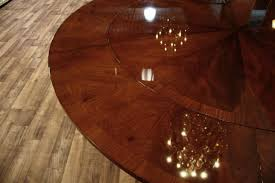 60 round dining table opens to 84 round dining table perimeter