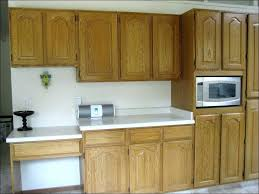 can you paint stained cabinets painting vs staining kitchen cabinets faced