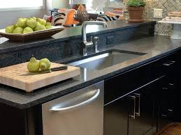 white sink black countertop choosing the right kitchen sink and faucet hgtv
