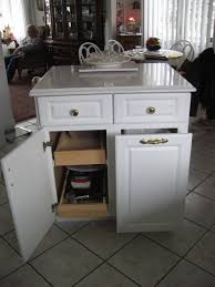 stylish kitchen island with trash can and pull out storage trays