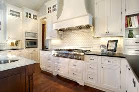 Cream Kitchen Cabinets With Blue Walls Herringbone Backsplash Transitional Kitchen Kristin Petro