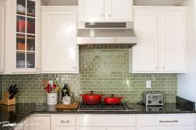 ideas for backsplash behind stove crema tile delta leland kitchen