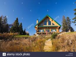 log home styles cottage style residential log home with green trim in autumn
