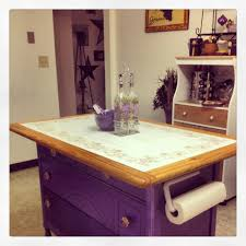 old kitchen table and an old dresser made into a kitchen island
