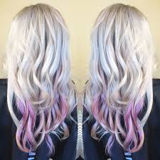 older women with platinum blonde pink hair platinum blonde hair with pastel pink balayage peekaboo highlights